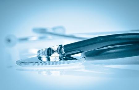 Stethoscope on a blue background photo