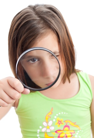 inspecting: Latin girl looking through a magnifying glass isolated on a white background