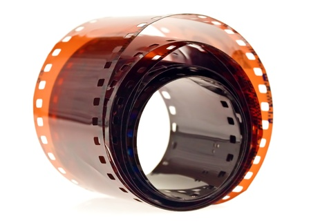 mm: Roll of 35 mm photographic film on a white background Stock Photo