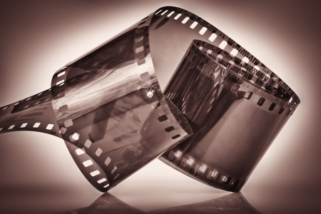 dramatically: 35 mm film on a dramatically illuminated dark depia background