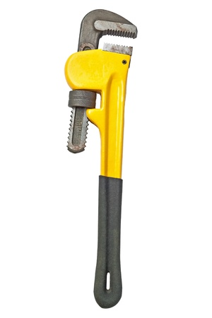 Yellow monkey wrench used for plumbing isolated on a white background  photo