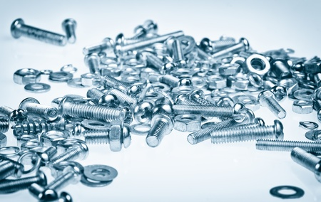 Nuts and bolts in a blue background photo