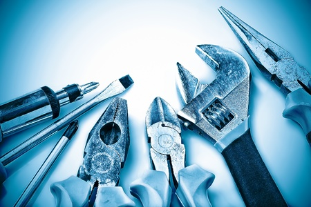Set of manual tools on a blue background