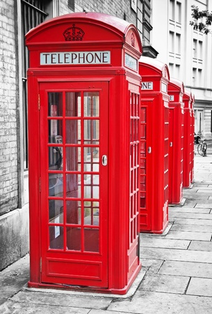 Row of traditionl red phone booths in London with a desaturated background Stock Photo - 9397646