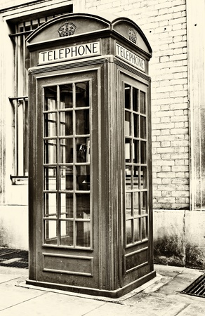 Old sepia image of a traditional phone booth in London