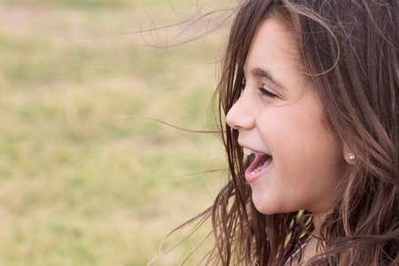 diffused: Happy small girl laughing with a diffused green background