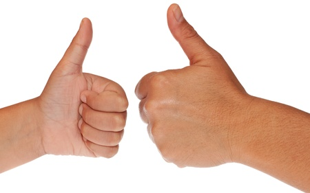 And adult and a child hand one in front of the other making the thumbs up sign on a white background Stock Photo - 9396704