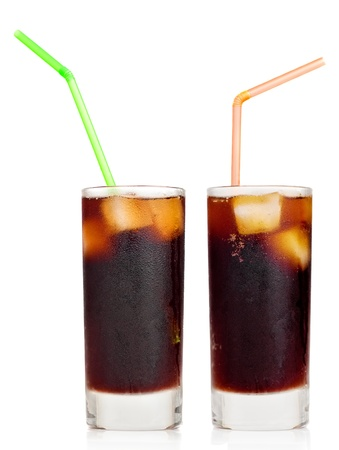 libre: Cola soft drink with ice or Cuba libre with a drinking straw on a white background with reflections