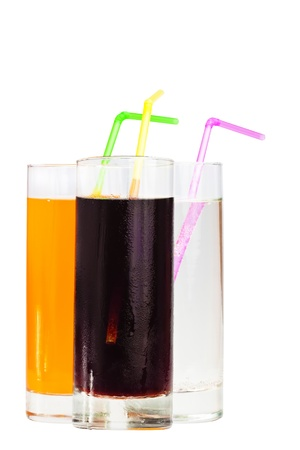 soft drinks: Three highball glasses of soda with drinking straws on a white background Stock Photo