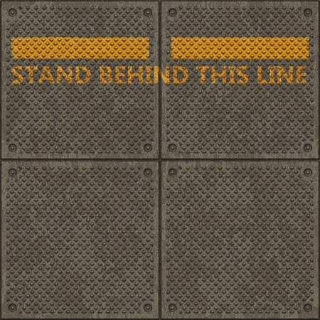 Seamless metal pavement textur with a yellow line and the words STAND BEHND THIS LINE photo