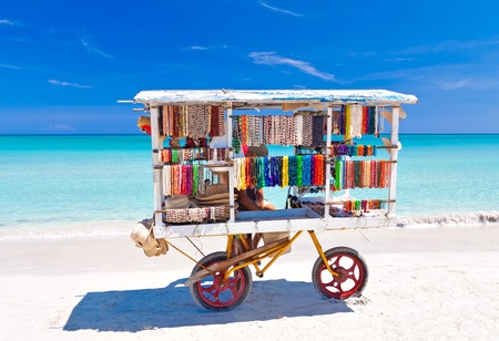 merchant: Cart selling typical souvenirs on the beautiful cuban beach of Varadero