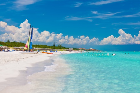 varadero: The beautiful cuban beach of Varadero with sailing boats, white sand and cristal clear turquoise water Stock Photo