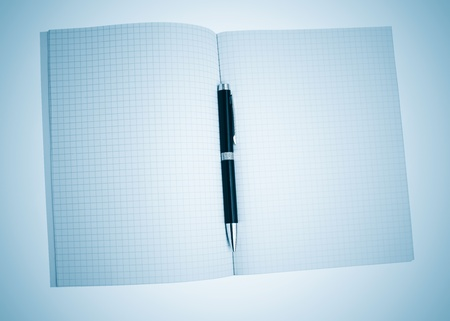 Math notebook and pen on a blue background Stock Photo - 10436888