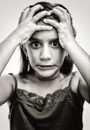 Dramatic image of a latin girl with an angry and desperate face Stock Photo - 10442662