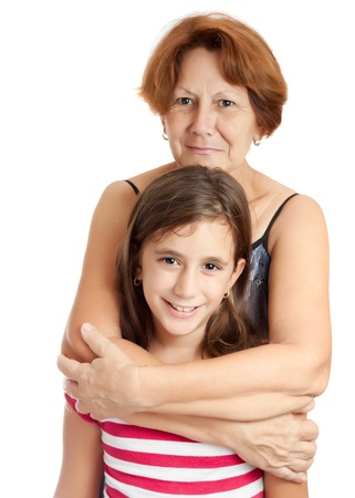 mature old generation: Latin grandmother hugging her granddaughter isolated on a white background