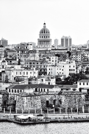 crumbling: Black and white image of Havana with several landmarks and crumbling old buildings