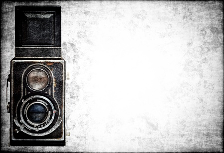 retro camera: Old classic analog camera on a grunge background with space for text