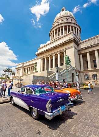 decades: HAVANA-MAY 3:Classic cars in front of the Capitol May 3,2011 in Havana.Cubans keep thousands of them running even when parts have not been made for decades and theyve become an icon of the country