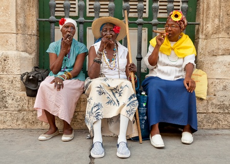 HAVANA-MAY 19:Old ladies with cigars May 19,2011 in Havana.Iconic characters like these are an attraction for the more than 2 million tourists who go to Cuba each year to enjoy its distinct culture Stock Photo - 10434515