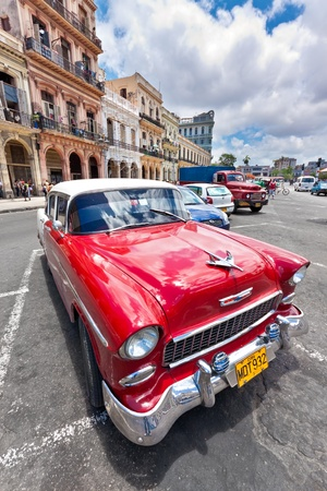 HAVANA-JUNE 4:Old Chevrolet in front of colorful buildings June 4,2011 in Havana.Cubans keep thousands of classic cars running despite the lack of parts and theyve become an icon of the country