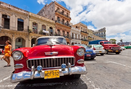 HAVANA-JUNE 4:Old Chevrolet in front of colorful buildings June 4,2011 in Havana.Cubans keep thousands of classic cars running despite the lack of parts and theyve become an icon of the country Editorial