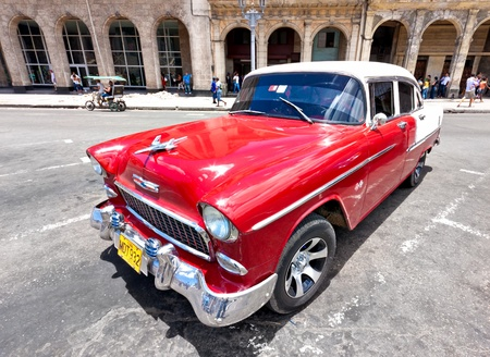 despite: HAVANA-JUNE 4:Old Chevrolet in front of colorful buildings June 4,2011 in Havana.Cubans keep thousands of classic cars running despite the lack of parts and theyve become an icon of the country Editorial