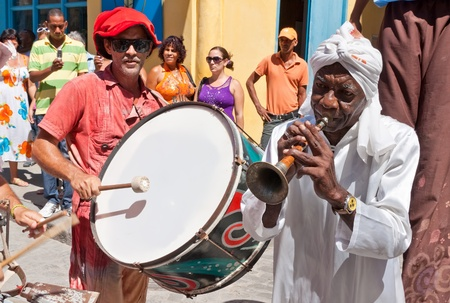 HAVANA-JUNE 4:Musicians in Old Havana June 4,2011 in Havana.Street artists performing in the colonial city help to give this area the colorful atmosphere which attracts over 2 million tourists a year Stock Photo - 10434543