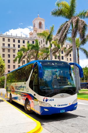 HAVANA-JUNE 26:Touristic bus parked in front of the Hotel Nacional June 26,2011 in Havana.This hotel,opened in 1930,is an icon for tourism in Cuba;an industry attracting over 2 million people a year