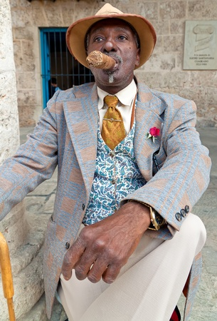HAVANA-MARCH 28:Old elegant man with a huge cuban cigar March 28,2011 in Havana.A symbol of Cuba,cigars are the most prestigious product of the island attracting visitors from all over the world