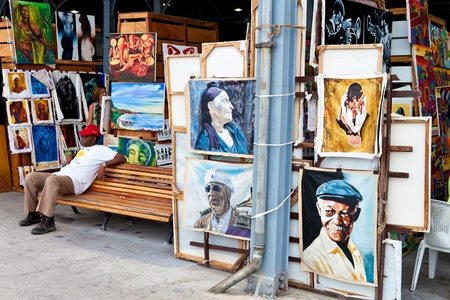 HAVANA-APRIL 2:Art market in Havanas old harbours April 2,2011 in Havana.One of Havanas tourist attractions,this fair sells paintings of iconic cuban themes and famous artistic or political figures