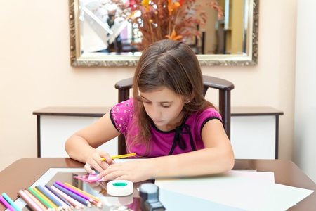 Beautiful small hispanic girl working on her art project at home Stock Photo - 10442696