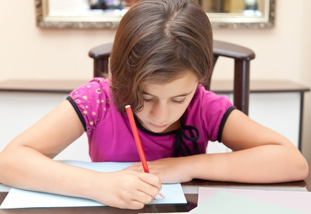 young schoolgirl: Small latin girl working on her homework