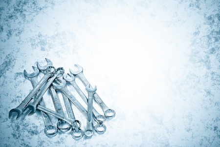 spanners: Metallic blue  image of a set of spanners with space for text