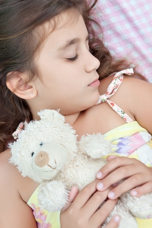 Latin girl sleeping with her teddy bear Stock Photo - 10453351