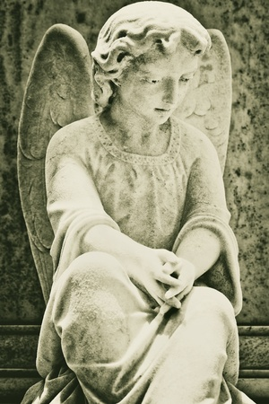 angel statue: Old statue of a very sad angel