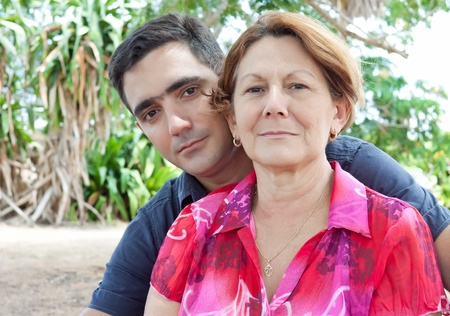 Latin man and older woman in a park photo