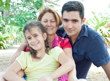 Latin family sitting in a park Stock Photo - 10453463