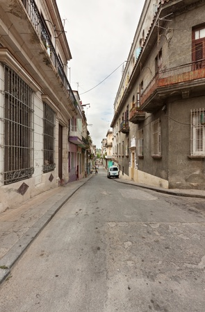 A street with typical buildings in Old Havana photo