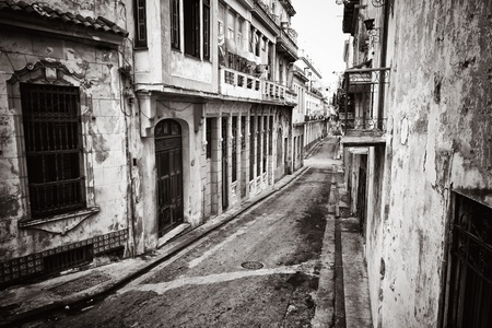 decaying: Grunge monochromatic image of a decaying buildings in Old Havana Stock Photo