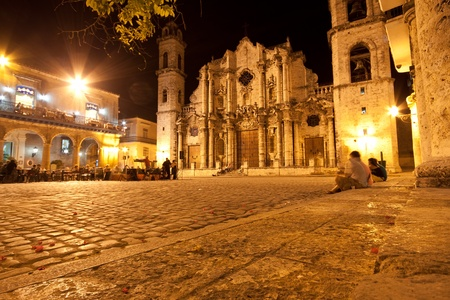adjacent: The Cathedral of Havana and its adjacent square in the colonial neighborhood of Old Havana illuminated at night