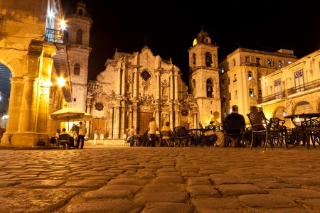 The Cathedral of Havana and its adjacent square in the colonial neighborhood of Old Havana illuminated at night