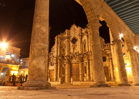 colonial: The Cathedral of Havana and its ajdacent square illuminated at night