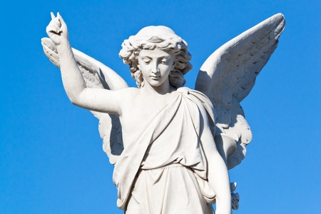 christianism: beautiful angel with a blue sky background