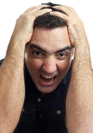 Latin man yelling with his hands on his head and a violent or desperate face isolated on a white background Stock Photo - 10442724