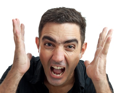 desperate face: Latin man yelling with a violent or desperate face isolated on a white background Stock Photo