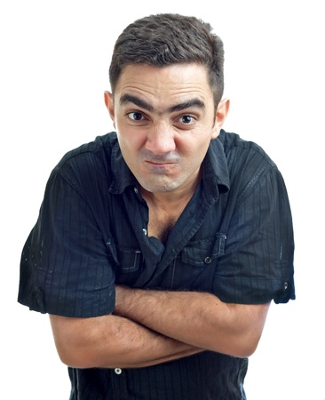 furious: Latin man with his arms crossed and a funny angry face isolated on a white background Stock Photo