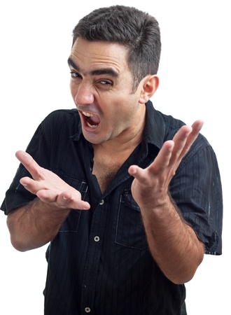 Latin man yelling with a violent or desperate face isolated on a white background Stock Photo - 10442692