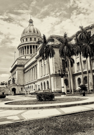 adjacent: Vintage sepia view of the Capitol of Havana and its adjacent garden