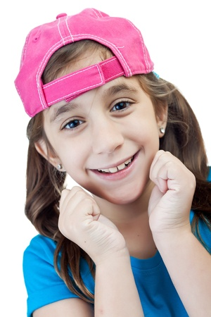 Hispanic girl wearing a backwards cap with a happy expression photo