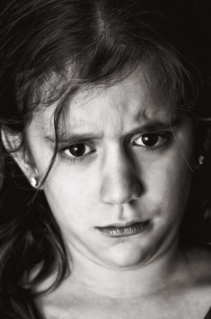 Black and white image of a very sad girl photo